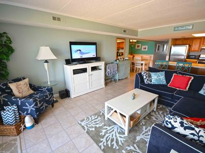 Photo for Cute, stylish luxury 2-bedroom oceanfront condo with WiFi and family-friendly furnishings located midtown just steps to the beach!
