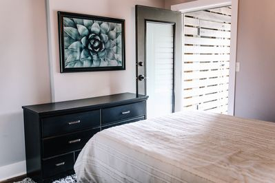 Bedroom with access to back patio.