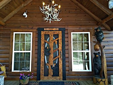 Front View Of Lodge With Locally Handcrafted Door & Bear Statue
