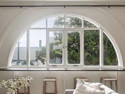 Beautiful arched window at front of apartment