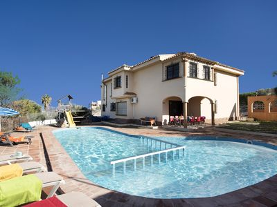 Photo for Villa for 15 people with large pool, private garden and fabulous views.