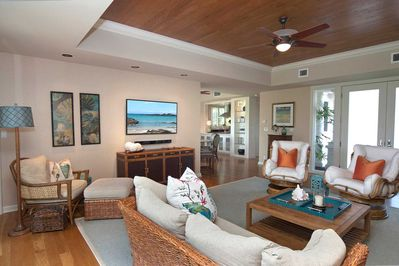 Wood recessed ceilings w/fans contribute to our Hawaiian, laid back ocean decor