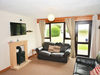 Photo for Spacious house on family holiday park with outdoor pool and entertainment.