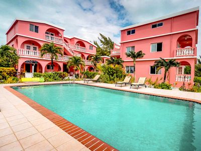 Photo for Spacious, oceanfront condo with a shared pool - just steps from the beach!