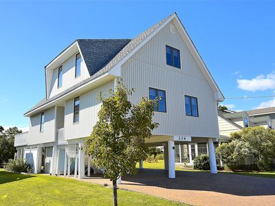 "Photo for FREE ACTIVITIES INCLUDED!!!  Located ocean side in the heart of Bethany Beach this charming family friendly vacation home backs up to the historic ""Bethany Loop Canal"" with amazing beautiful back yard plus dock."