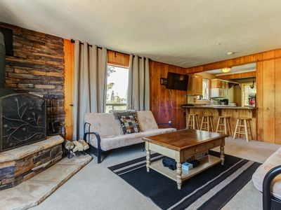 Photo for NEW LISTING! Ski-in/out condo w/cozy mtn warmth - deck, free WiFi, walk to lifts