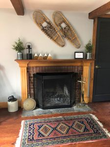Spacious living room with open fireplace. Great for relaxing year round!