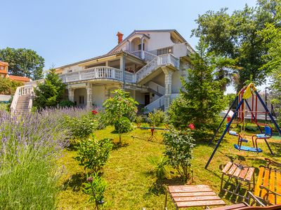 Photo for Apartment with 3 bedrooms, WiFi, BBQ, garden with children's swing and only 500 meters to the sandy beach