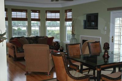 Our condo's living room / dining room with gas fireplace and bay view