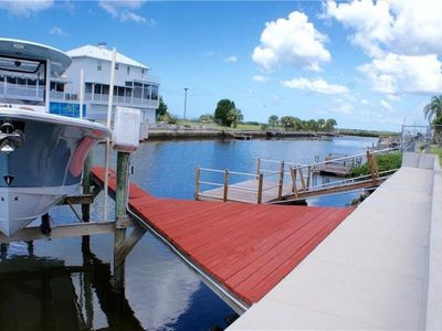 Photo for Waterfront Canal Home just 8 min from the gulf. Floating dock and boat lift