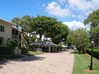 Photo for Private beach access lake view condo in Pelican Bay