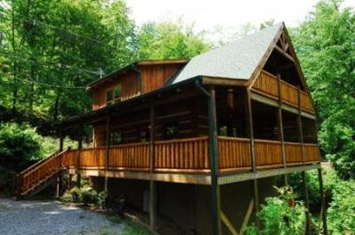 Covered porches on 2 levels with porch swing on upper deck off the master suite.