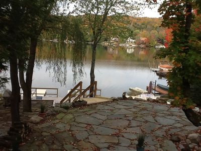 lakefront cabin, beautifully landscaped with flagstones
