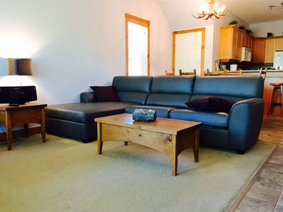 living room with cozy couch that pulls out into double bed