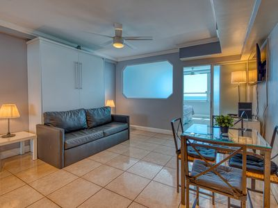 Photo for Cute oceanfront condo w/ shared pool, bar, and gym!