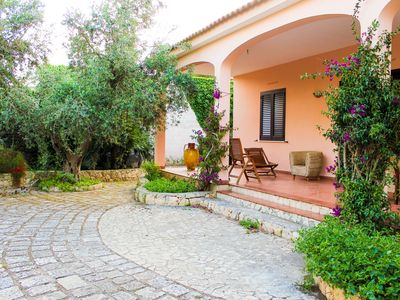 Photo for EXCLUSIVE VILLA IMMERSED IN THE GARDEN TWO STEPS FROM THE SEA