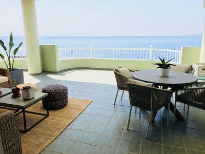 Photo for Right on the beach quiet apartment with a large terrace
