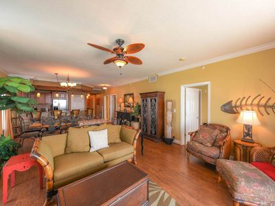 Photo for Welcoming, tropical condo ! Free beach service! Two lagoon pools + movie center on-site!