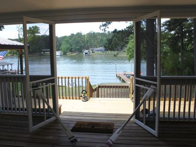 Screened Deck looking at open Deck to the Lake.