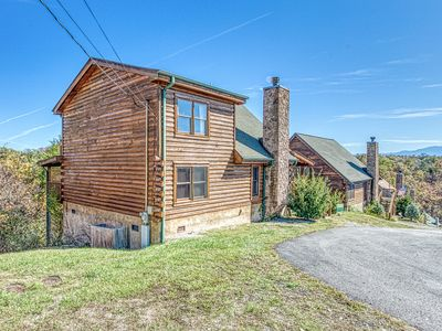 Photo for Charming cabin w/ private hot tub, game room & shared seasonal pool!