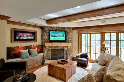 Living room with gas fireplace, flat screen TV
