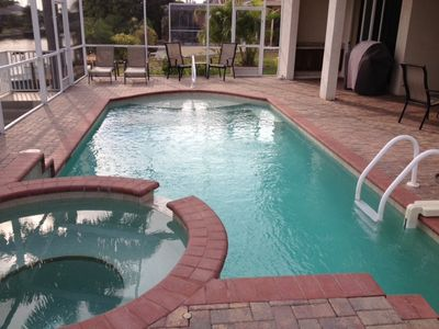 Pool & Spa on Lanai. The wet bar, grill and table are on the patio by the pool.