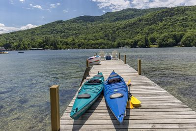 Two kayaks, a paddle board and water floats are available for use