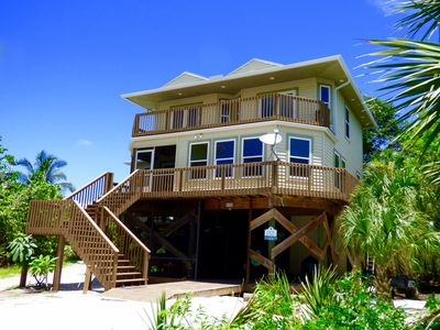 Photo for Redfish Retreat:  dock slip, luxurious home,  free jon boat, golf cart available