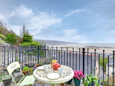 Photo for In an elevated position above Barmouth, with a panoramic view over the long, sandy beach and Cardiga
