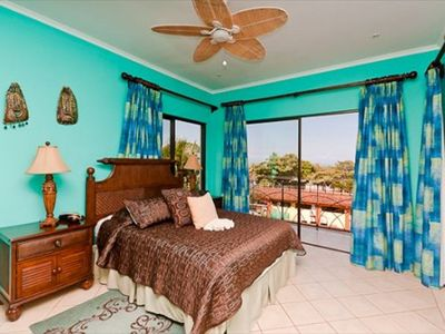 Master Bedroom - A spacious and beautiful master bedroom with king size bed and ocean view