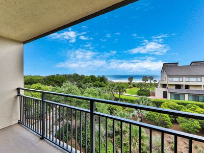 Photo for Elegant ocean view townhome w/ beach access, shared pool & perfect location!