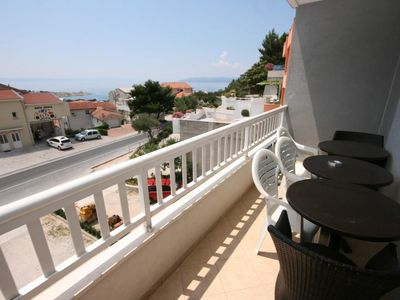 Photo for Two bedroom apartment with terrace and sea view Makarska (A-6641-b)