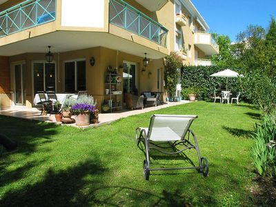 Photo for Holiday rental with lovely garden 300m from the sandy beach