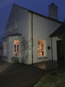 A night view of the house at Christmas time.