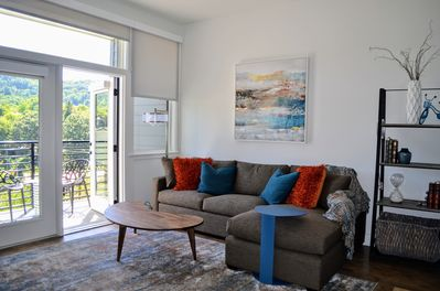 Comfortable sectional with lovely view, art work by local artist Mark Bettis