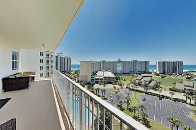 Balcony - Relax with a crisp beverage on the spacious Gulf-view balcony, which provides cushioned seating for the group.
