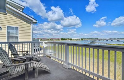 Photo for Waters Edge 114 - Beautiful beach condo with marsh and river views with seasonal community pool