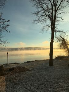 Mists rising from the lake on a cool October morning.