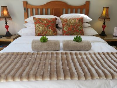 Photo for Self-catering, spacious Bachelors flat, WiFi, DSTV, garden-patio, secure parking