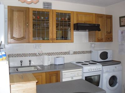 Usual appliances also dish washer, Washing up liquid, dish cloths, t towels