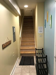 Drop your shoes and head on up!  (First floor entry)