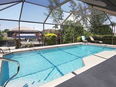 Photo for 26% OFF! -SWFL Rentals - Villa Ellie Mona - Pleasant Waterfront Home with Heated Pool