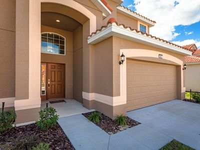 Photo for 6 BEDROOM/4.5 Bath New Home w/pool and hot tub. Sleeps 12. Minutes to Disney.