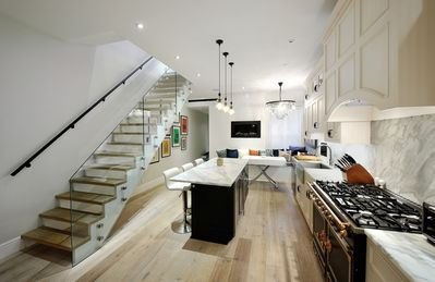 Kitchen with stairs to Mancave/3rd Bedroom