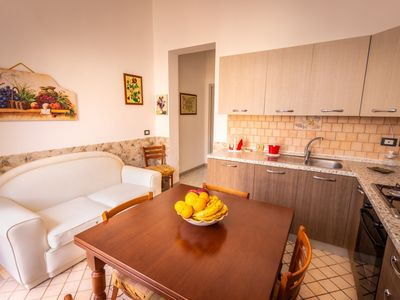 Photo for Apartment just 50 meters from the sea, wifi, air conditioning, veranda.