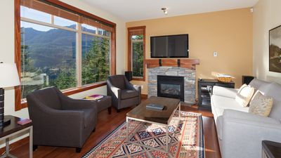 Cozy Living Room with Gas Fireplace, Flat Screen TV