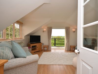 Enjoy the views from the comfort of one of the two sofas