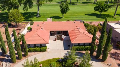 Ariel view home is located on 10th green of Oak Creek Golf course