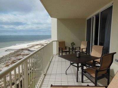 Spacious balcony overlooking pool, beach, gulf. 4 chairs and table, 2 recliners.