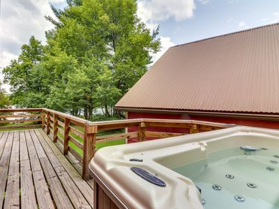 Photo for Lakefront cabin w/ private dock, hot tub, & game room - dogs okay!